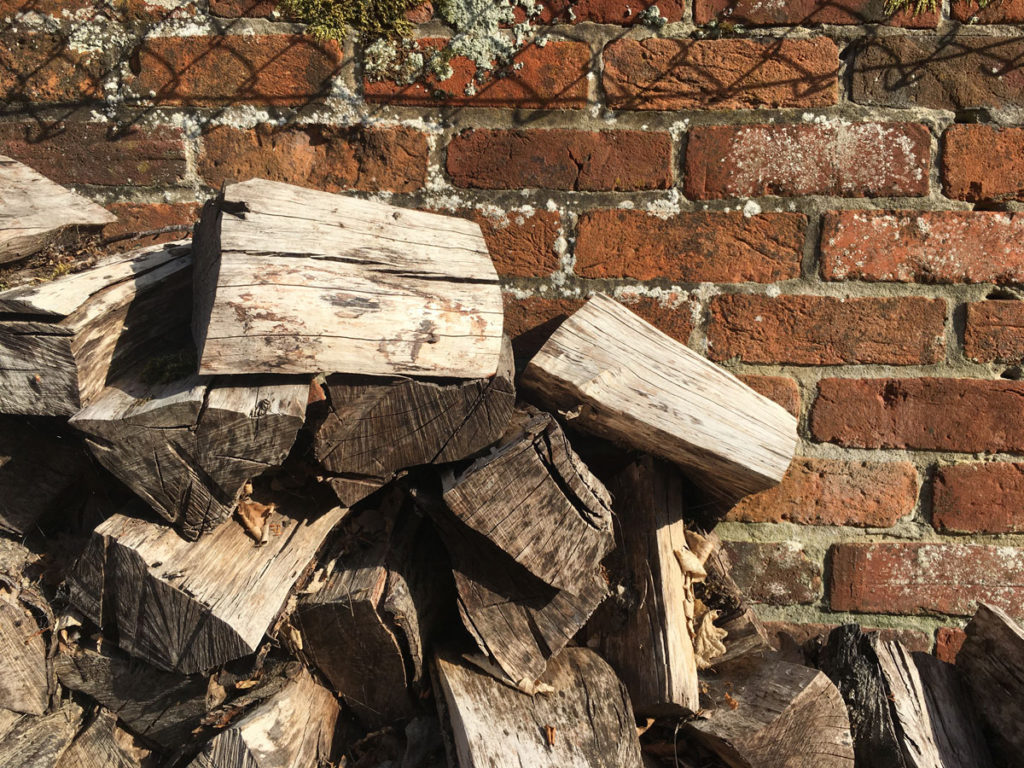 outdoor log piles come in handy when you want to use some for covering the soil in a plant pot. A cat wouldn't be able to get to the soil to use as a toilet.